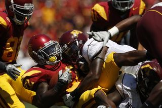 Minnesota Golden Gophers and USC Trojans